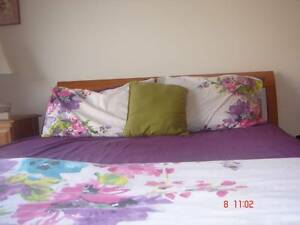 Queen bed with pellow top mattress and one bedside. Mowbray Launceston Area Preview