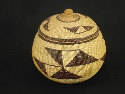 A well-woven Hupa basket with cover, Native American Indian, circa: 1910