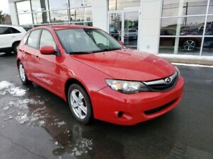 2010 Subaru Impreza AWD. 2 sets rims and tires incl.