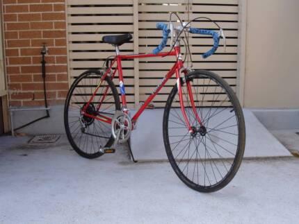 Black Wheels Red Road Bike