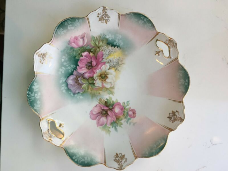 "Porcelain Plate marked Russia pretty with flowers 10"" across"