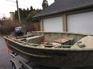 12 ft welded aluminum boat and trailer with 25 hp Yamaha