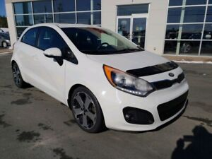 2013 Kia Rio SX. Auto, leather, roof. 2 sets rims and tires Incl