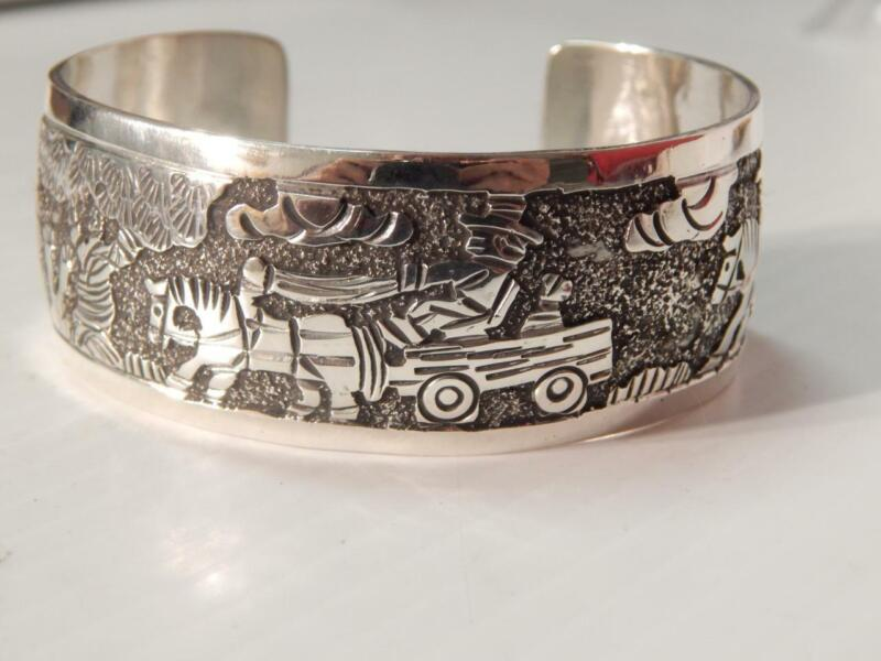 NAVAJO INDIAN STERLING SILVER STORYTELLER PICTORIAL CUFF BRACELET  by E. BECENTI