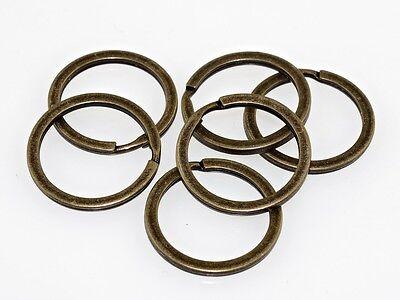 10 kleine Schlüsselringe in antik bronzefarben ()