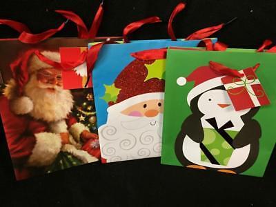 Set 3 medium sparkly Christmas gift bags wrap party Santa penguin 9