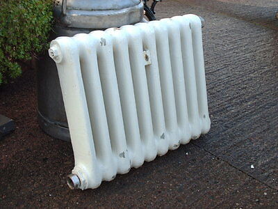 SMALL VINTAGE  CAST  IRON  RADIATOR .