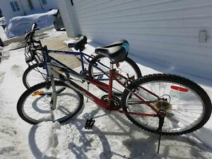 Two red and black mountain bikes