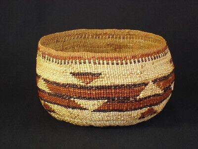 A Hupa polychrome basket, Native American Indian, circa: 1910