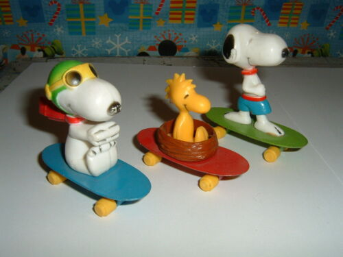 1966 Snoopy on Green Skateboard, Snoopy Flying Ace on SB. Woodstock on SB