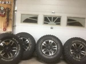 "4-35"" Mickey Thompson M/T on ford rims"