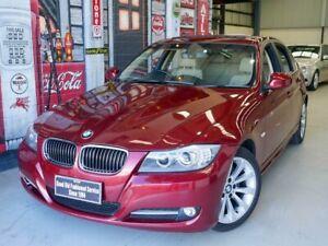 2010 BMW 3 Series E90 MY10 320i Steptronic Executive Red 6 Speed Sports Automatic Sedan