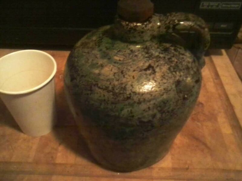 Antique Jug with wood stopper