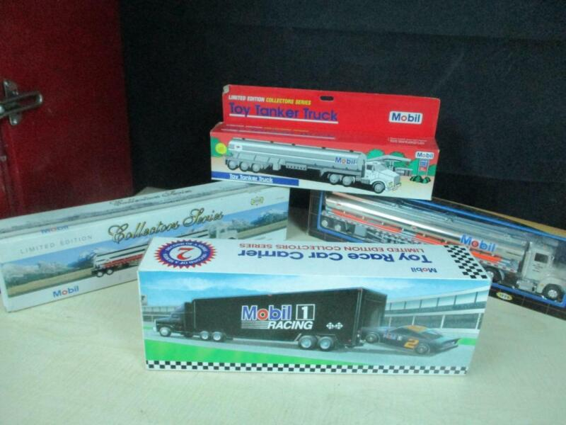 (4) DIFFERENT MOBIL OIL TOY TRUCKS GAS STATION OIL PREMIUMS PROMO MIB LOT NICE!