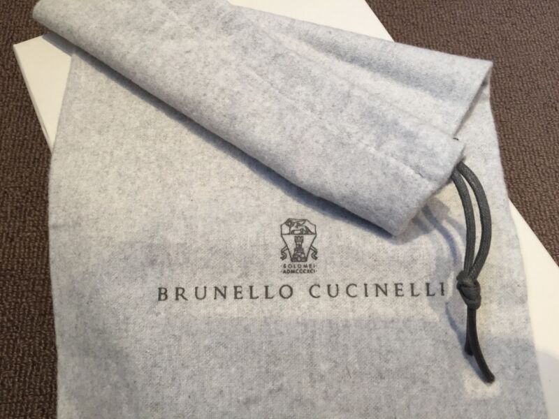100% Auth dust bag, logo is clear and crisp but a lighter shade of black, the material is cashmere like!