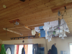 Cool homemade wood dowel laundry drying rack ceiling mount.