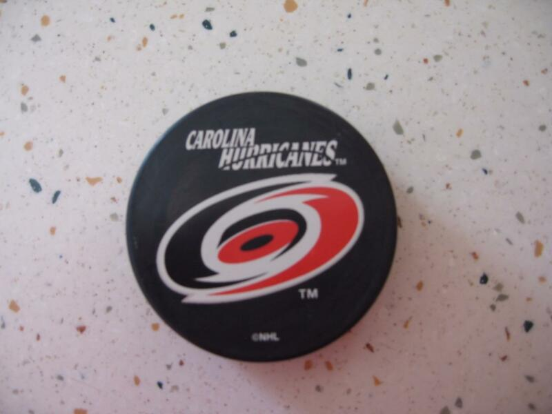 HOCKEY PUCK-PAIR OF CAROLINA HURRICANES PUCKS