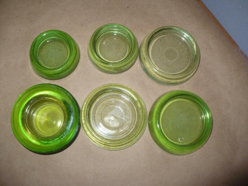 Six Vintage Green Glass Furniture Leg Coasters