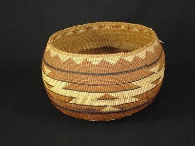 A Fine Polychrome Hupa Basket, Native American Indian, circa: 1910