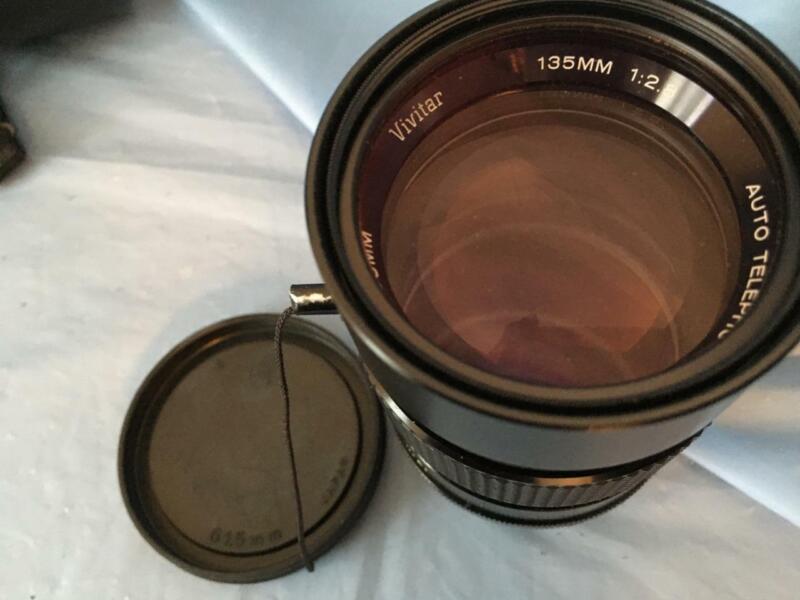 Vivitar telephoto lens + R M C Tokina lens + variety of lens