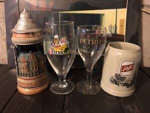 Collection of beer glasses and mugs