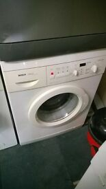 white bosch 1200 spin digital washing machine