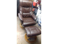 Brown Leather Recliner Swivel Chair and footstool