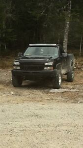 Lifted 06 silverado 4x4 trade for bike