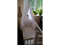 Baby swinging cot/crib in white with bedding