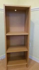 Narrow wooden bookcase