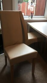 Four cream leather chairs
