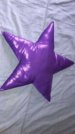 Metalic purple star decorative cushion