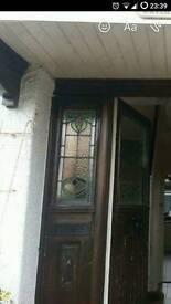 Original wooden door with stained glass