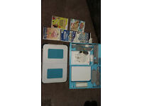 Nintendo Wii complete with Wii compatible board and games