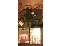 PS2 with cables, two memory cards and two games (Collection only)