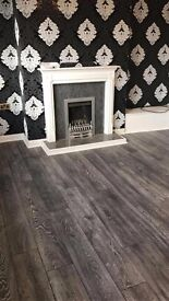 Fully fitted 8mm grey laminate with underlay beading door bar 20m2 5x4 £320