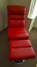 lovely looking red chair and foot stool.