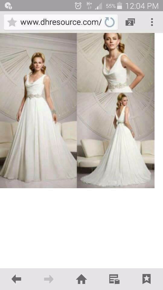 Wedding dress size 12 taken in from a size 14. Can be let back out or taken in to a size 10.