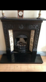 cast iron fireplace with marble hearth