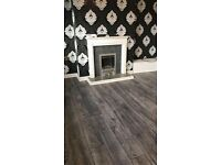 8mm charcoal and light grey laminate fully fitted with underlay beading door bar £320 5x4