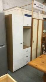 Wardrobe with storage at top, three drawers and mirror