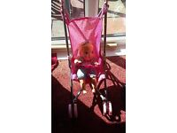 Girl's toy buggy with doll