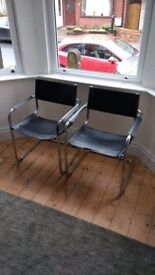 2 stylish vintage, mid century modern, black and chrome chairs