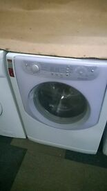 white hotpoint aqualtis 7.5kg 1200 spin washing machine