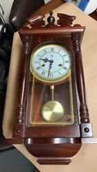 Polaris 31 Day Wind Up Wall Clock with Pendulum has instruction manual and key