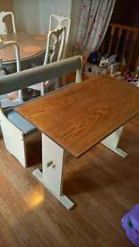 Shabby chic style wooden table with padded bench seat