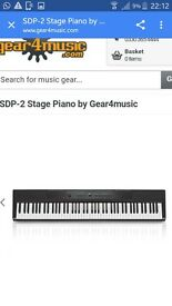 SDP-2 electric piano with stand, pedal and headphones. Used twice.