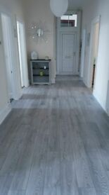 8mm grey and charcoal laminate flooring bundle 5x4 20m2 fully fittted £320
