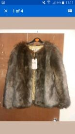Faux fur size 10 coat for sale in brand new condition