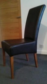 2 Brown faux leather chairs